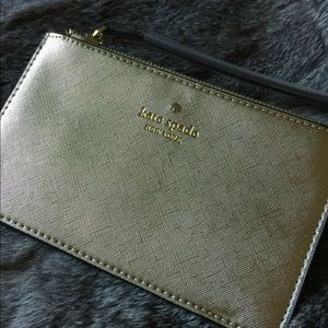 Gold colored Kate Spade Wristlet